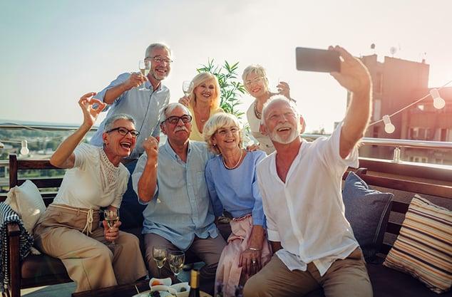 senior group selfie sun iStock-1054444342 760x500