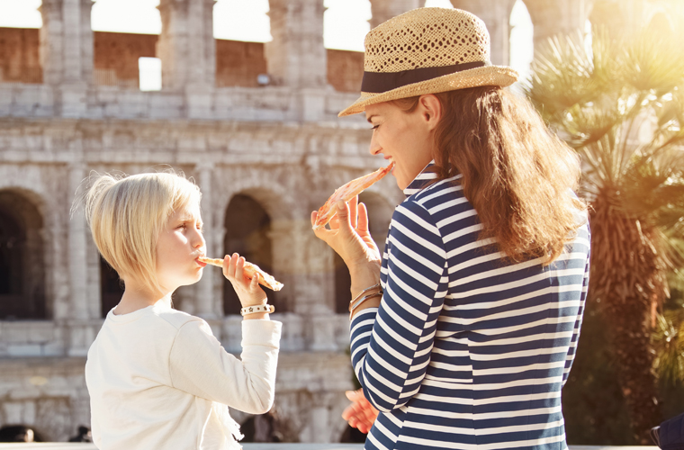 Italy_Rome_Colosseum_mother and daughter eating pizza 760x500