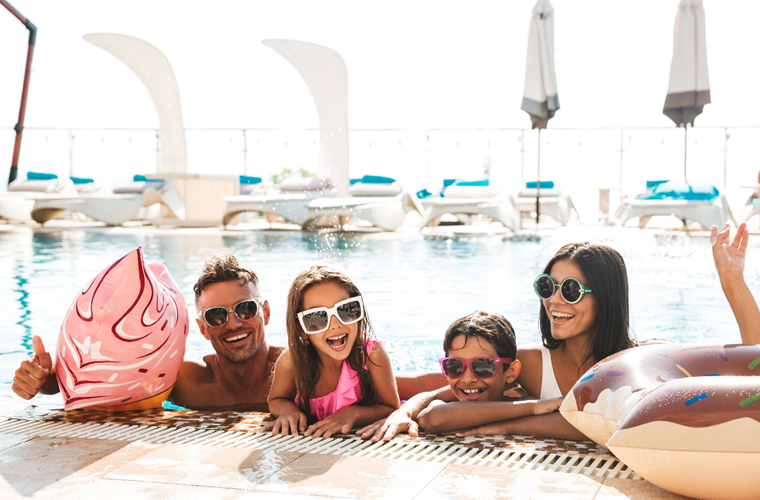 family in pool shutterstock_1155049519 760x500